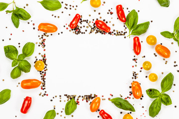 Basil, pepper and cherry tomatoes frame with copy space, on white background
