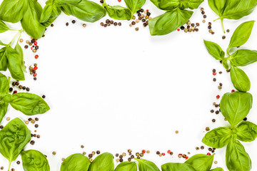 Basil and pepper frame with rectangular copy space, on white background