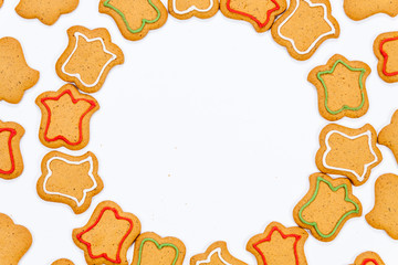Christmas gingerbread cookies with colorful icing isolated on white background