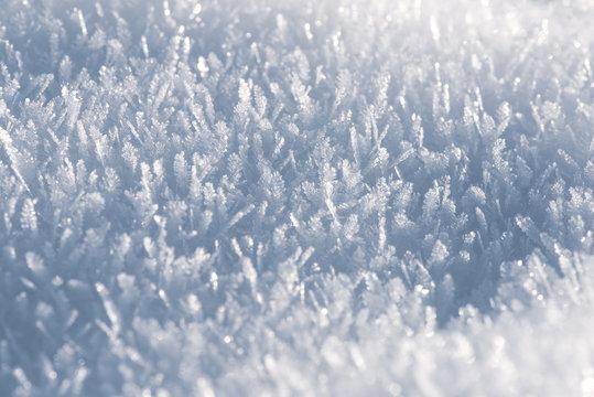Macro look of snow crystals, snowflakes. Winter background