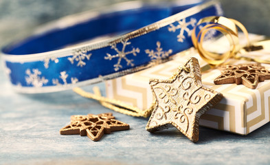 Christmas star, baubles and Christmas presents. Christmas decoration. Christmas time. Wooden background. Close up.