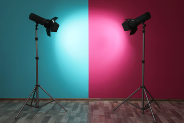 Professional lighting equipment near wall in photo studio. Space for text
