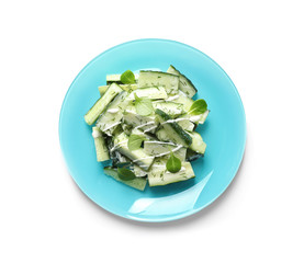 Plate with delicious cucumber salad on white background, top view