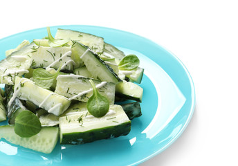 Plate with delicious cucumber salad on white background, closeup