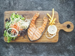 Salmon steak on chopping board
