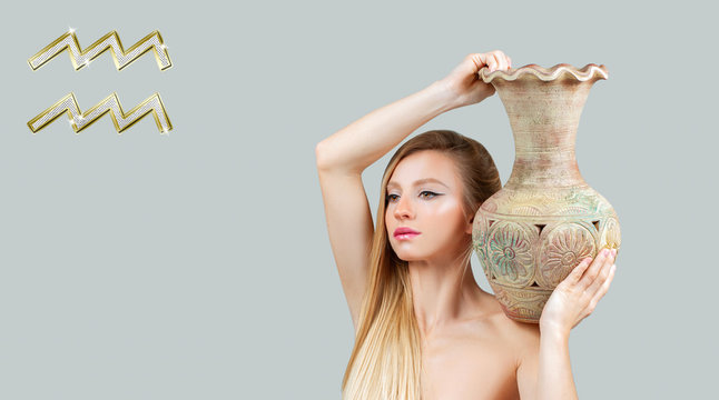 Aquarius Zodiac Sign. Astrology and horoscope concept. Beautiful woman with jug