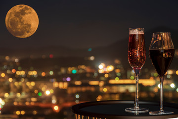 Rose wine or red wine, At night light over city background, Christmas festive celebration. End of the year, Welcome to New Year 2019. Good long holiday vacation with new thing when start up - Image