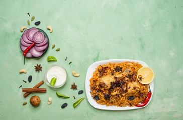 Traditional Arabic food: kabsa with chicken on a plate.