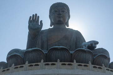 Closeup horizontal photo of Tian Tan Buddha, Lantau Island, Hong Kong. copy space in sky above buddha.