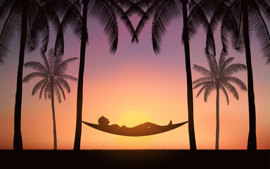 Silhouette palm tree with woman in hammock on beach under sunset sky background