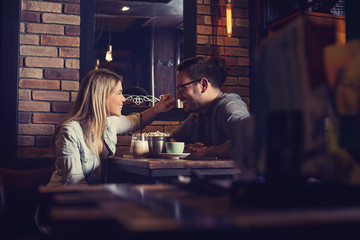 Beautiful couple on a romantic date in cafe.