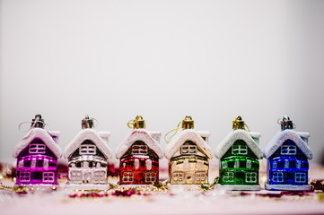 Christmas tree decorations in form of colored houses, snowflakes. New Year city banners with traditional europe houses. Happy New Year and Merry Christmas concept. Greeting card with place for text.