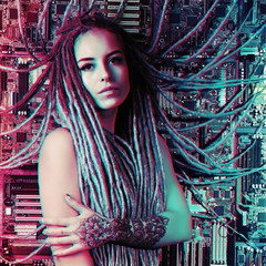 Portrait of a girl with a tattoo and dreadlocks tied to the motherboard. Internet addiction concept. Cyberpunk toning
