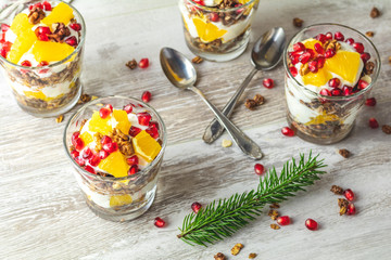 Greek yogurt with granola and orange for healthy breakfast