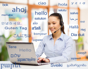 translation, business and technology concept - smiling female translator or operator with computer...