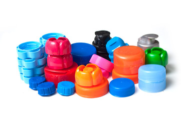 closeup of colorful plastic plugs for recycling on white background
