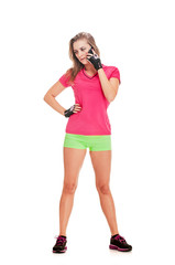 Slim athletic sporty woman talking on mobile phone