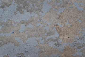 Blue dirty peeled wall with falling off flakes. Old weathered painted wall background texture.