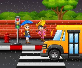Cartoon two girl carrying umbrella under the rain on the roadside