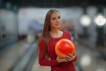 Young woman with bowling ball