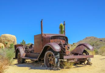 Old truck in Joshua Tree with blue skies desert scenery
