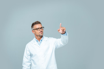handsome scientist in white coat touching something in air isolated on white, artificial intelligence concept