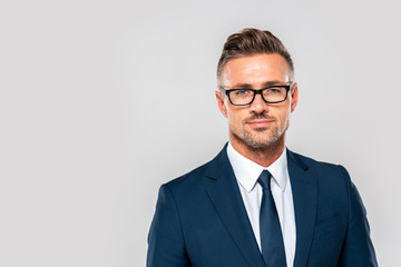portrait of handsome businessman in suit and glasses looking at camera isolated on white Wall mural