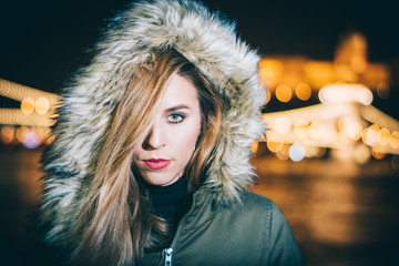 Beautiful woman outdoor, city lights on background. Budapest, Hungary.