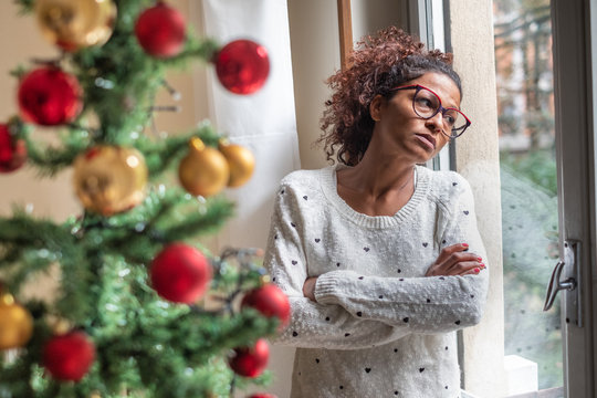 Sad young woman celebrating Christmas at home
