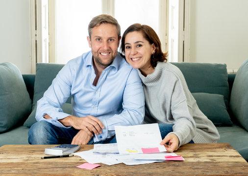happy young couple feeling proud of home finance