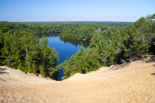 Au Sable River Wilderness Overlook. Overlook along the River Road Scenic Byway of the Huron National Forest wilderness with the famous Au Sable River in the lush green forests of Michigan.