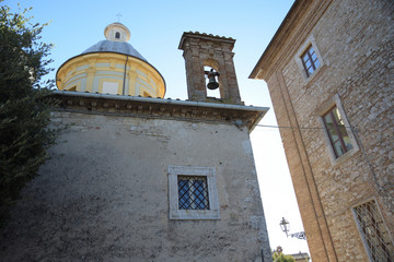 alley of Italian village with bell