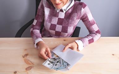 businesswoman envelope money bribe