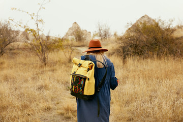 Travel. Woman Traveling With Backpack At Field