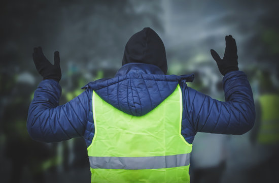 Man in a yellow vest protesting