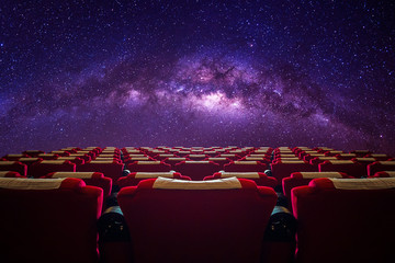 Cinema hall with red seat in Milky way galaxy.