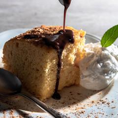 Vanilla cake with chocolate fudge and ice cream