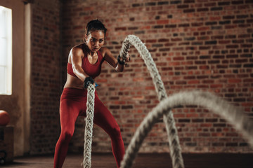 Battle rope workout at fitness studio Wall mural