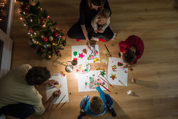 Family of five making holiday decorations