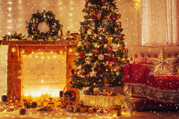 Christmas living room interior, decorated wood mantelpiece, lit tree with red gold green baubles, stars, wreath, candles, lightly toned, cosy chair with red cover, created snow, selective focus