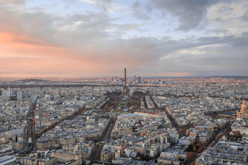 aerial view of the city of paris and the eiffel tower at sunset in france