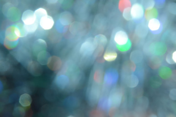 Bokeh photo. Holiday background. Christmas lights. background. Defocused sparkles. New Year backdrop. Festive wallpaper. Blinks. Carnival. Retro style photo. Holographic.