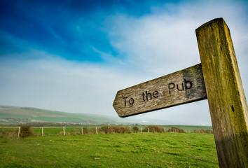 To the pub sign in rural setting