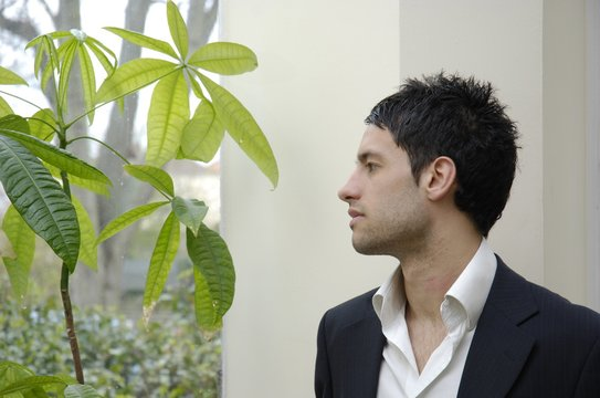 Stock photo of young businessman with green concerns.