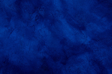 Dark blue marble or cracked concrete background (as an abstract mystical background or marble or concrete texture)