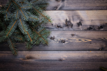 Fresh spruce twigs. Wooden gray table of planks on which spruce twigs are laid out. winter card background