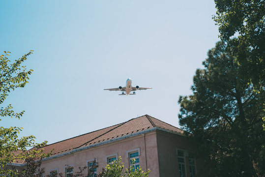 Plane flying over residential building
