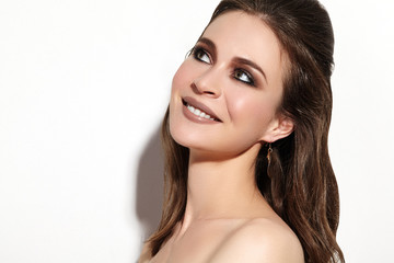 Beautiful Smiling Woman with Clean Skin, Celebrate Make-Up. Joyfull and Happiness. Christmas Party Fashion Look