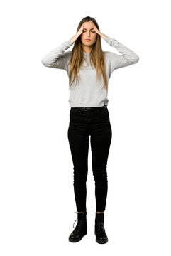 Full-length shot of young girl unhappy and frustrated with something on isolated white background