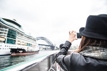 Tourist Photographing Cruise Ship